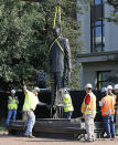 The statue of Harry F. Byrd, Sr., former Virginia Governor and U. S. Senator, is removed from the pedestal in Capitol Square in Richmond, Va. Wednesday, July 7, 2021. The General Assembly approved the removal during the last session. (Bob Brown/Richmond Times-Dispatch via AP)