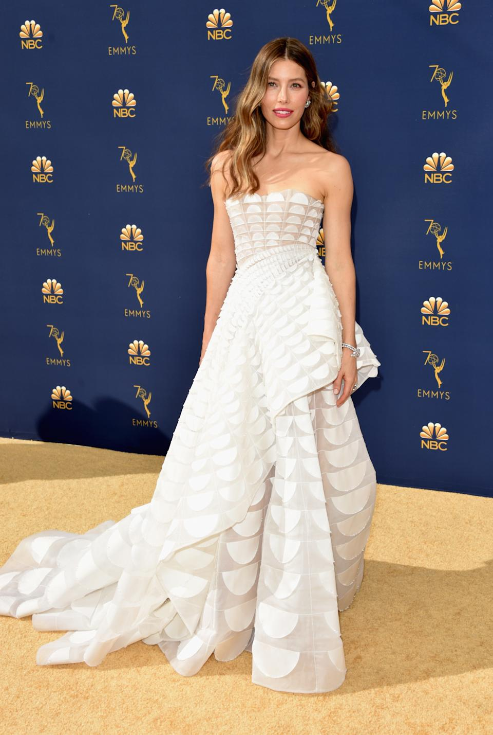 <p>Jessica Biel looked glamorous in a strapless gown with geometric detailing by Ralph & Russo at the 2018 Emmy Awards. (Image via Getty Images)</p>