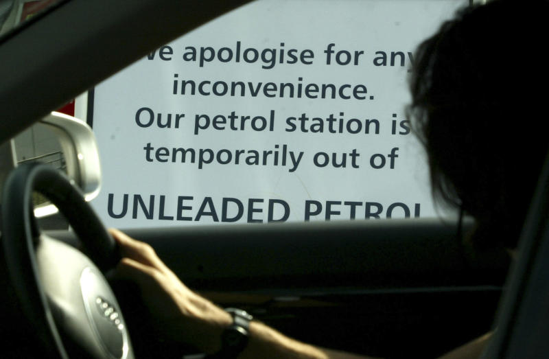 "FILE - In this Wednesday Sept, 14, 2005  file photo  a motorist drives past a sign posted out side a petrol station informing customers the station is out of unleaded petrol in Dagenham, east of London.   George Bernard Shaw once observed that England and America were two countries divided by a common language.  He was right on the money. Or should that be ""spot on?, Thinking of driving? Anything to do with cars can be oh-so confusing _ and not just because you drive on the left side of the road here! A car runs on ""petrol,"" not gas. You fill up at a ""petrol station"" where petrol is measured in ""litres"" not gallons. (AP Photos/Sergio Dionisio, File)"