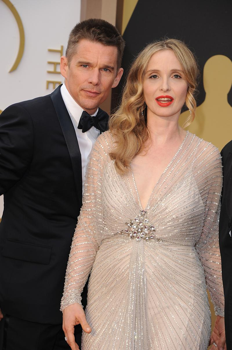 HOLLYWOOD, CA - MARCH 02: Actor/screenwriter Ethan Hawke (L) and actress/screenwriter Julie Delpy attend the Oscars held at Hollywood & Highland Center on March 2, 2014 in Hollywood, California. (Photo by Steve Granitz/WireImage)