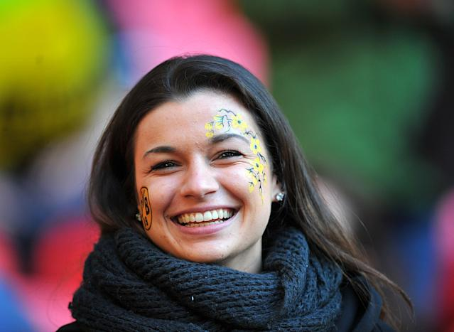A Borussia Dortmund with her face painted in the stands
