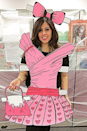 <p>Because if you can't be the real thing, the paper version is the best option. To create this funky 2-D design, make a dress, handbag, and bow out of colored poster board. </p>