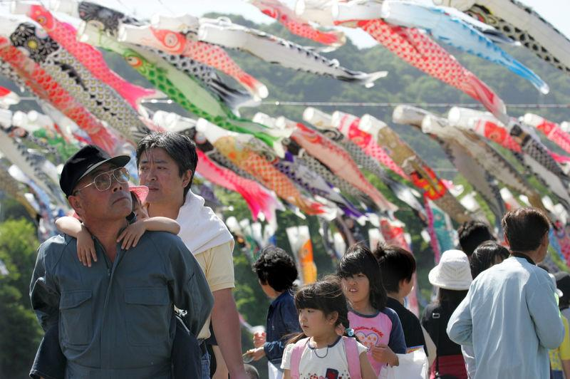 FILE PHOTO : Holidaymakers view thousands of carp streamaers in Sagamihara, Japan.