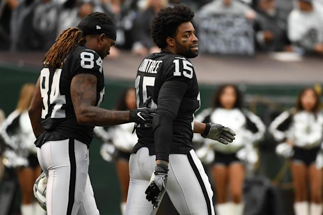 <p>Michael Crabtree #15 of the Oakland Raiders is walked off the field by Cordarrelle Patterson #84 after being ejected for fighting with Aqib Talib #21 of the Denver Broncos during their NFL game at Oakland-Alameda County Coliseum on November 26, 2017 in Oakland, California. (Photo by Robert Reiners/Getty Images) </p>
