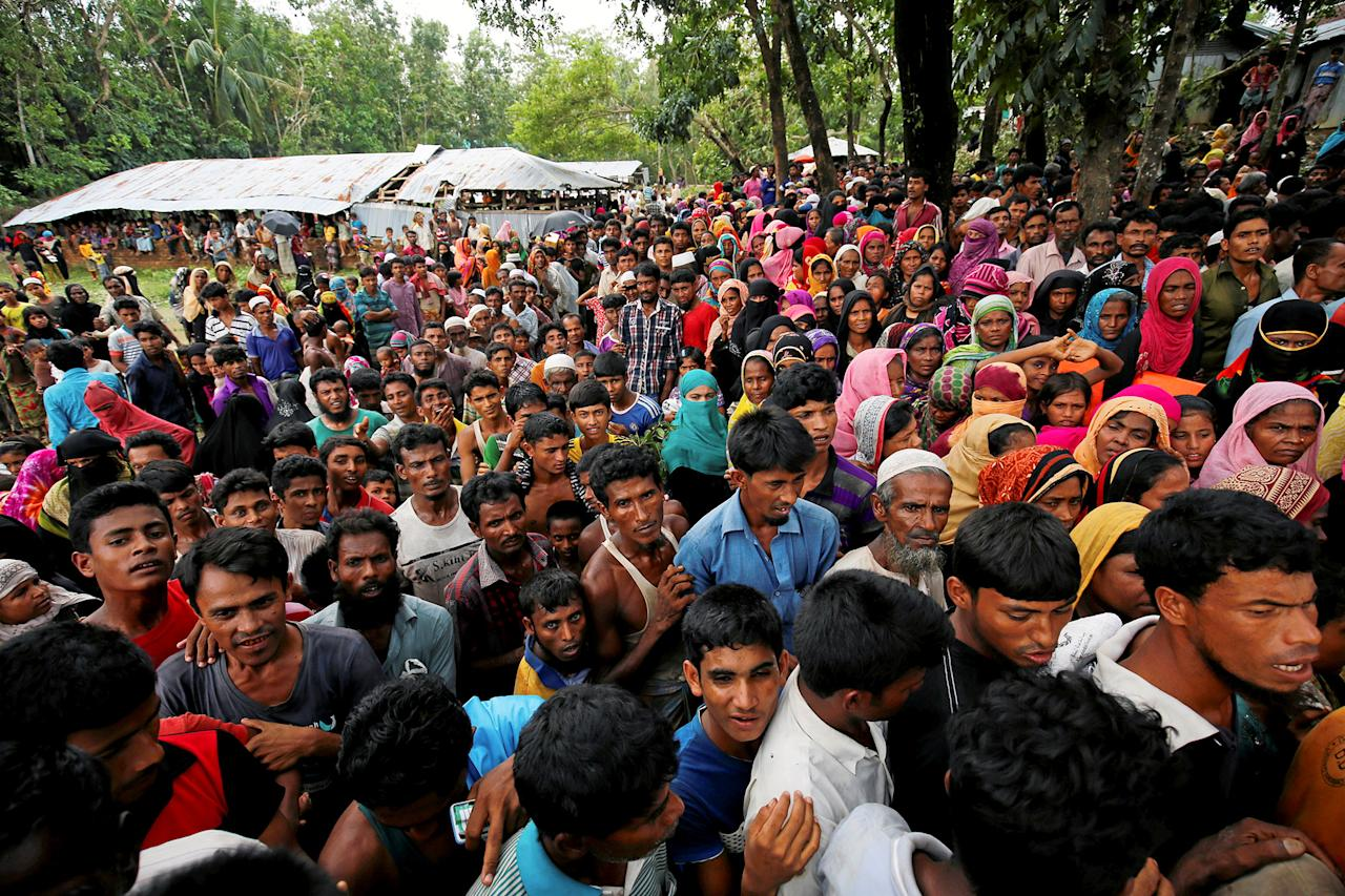 <p>Rohingya refugees gather to collect relief at the Balukhali Makeshift Refugee Camp as they are affected by Cyclone Mora in Coxís Bazar, Bangladesh, May 31, 2017. (Mohammad Ponir Hossain/Reuters) </p>