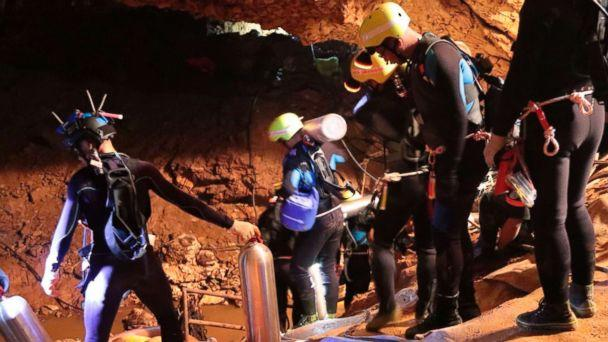 PHOTO: Thai rescue team members walk inside a cave where 12 boys and their soccer coach have been trapped since June 23, in Mae Sai, Chiang Rai province, northern Thailand in this undated photo released by Royal Thai Navy, July 7, 2018. (Royal Thai Navy via AP)
