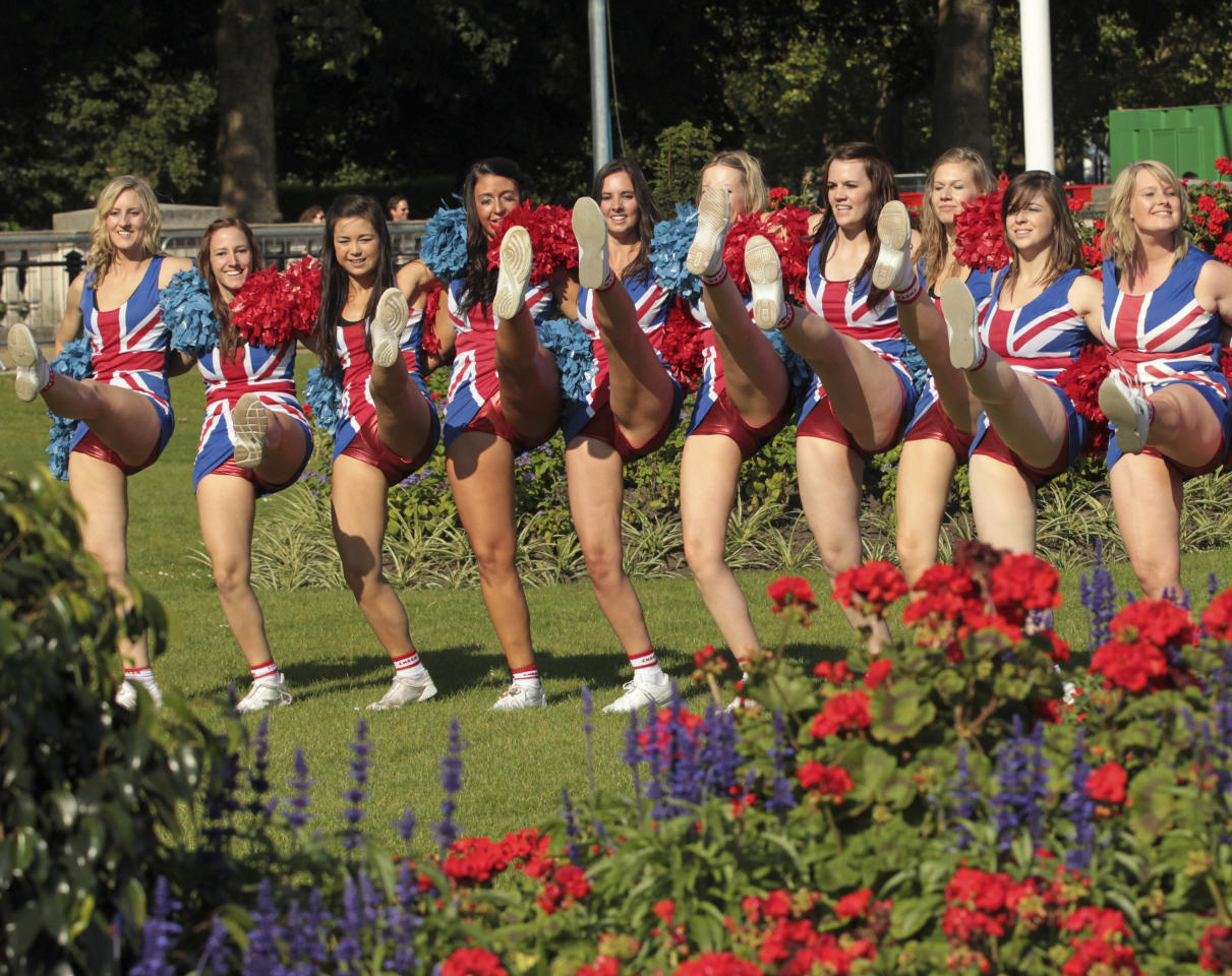 Cheerleaders practise a Cheer Team GB routine near Green Park in central London July 22, 2012. REUTERS/Olivia Harris (BRITAIN - Tags: SPORT OLYMPICS)