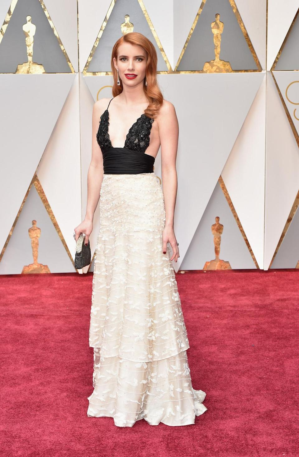 <p>Emma Roberts pulled from the Armani Privé archive for her black and white Oscars look. <em>(Photo: Getty Images)</em> </p>
