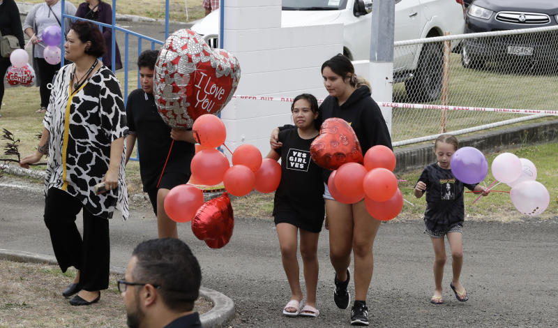 Families at Whakatane carry balloons ahead of the blessing. Source: AP