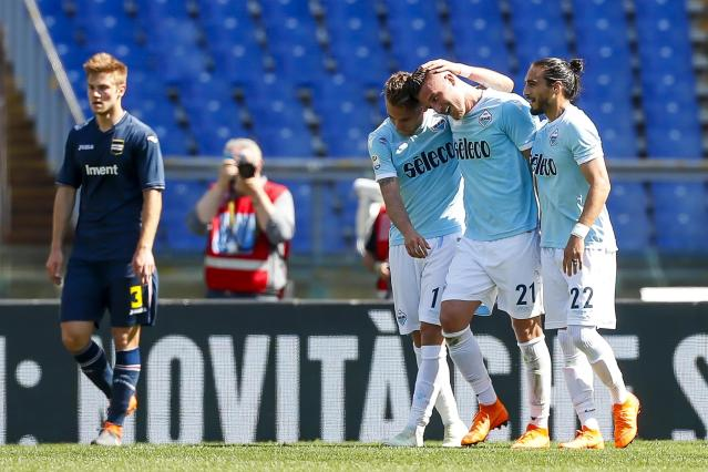 Lazio's Sergej Milinkovic-Savic, 2nd right, celebrates with his teammates Ciro Immobile, left, and Martin Caceres after scoring during the Serie A soccer match between Lazio and Sampdoria at the Rome Olympic stadium Sunday, April 22, 2018. (Angelo Carconi/ANSA via AP)