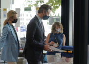 """California Gov. Gavin Newsom, casts his ballot for the recall election at a voting center in Sacramento, Calif., Friday, Sept. 10, 2021. Newsom was accompanied by his wife, First Partner Jennifer, Siebel Newsom, left. The last day to vote in the recall election is Tuesday, Sept. 14. A majority of voters must mark """"no"""" on the recall to keep Newsom in office. (AP Photo/Rich Pedroncelli)"""