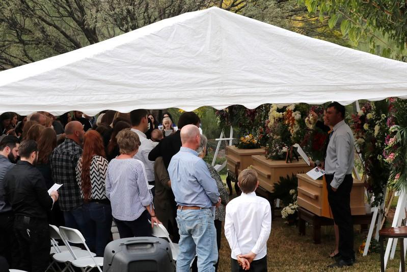 Relatives attend the funeral service of Dawna Ray Langford, 43, and her sons Trevor and Rogan, who were killed by unknown assailants, before they are buried at the cemetery in La Mora