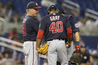 Washington Nationals pitching coach Jim Hickey (48) talks to pitcher Josiah Gray (40) and catcher Alex Avila during the sixth inning of a baseball game against the Miami Marlins, Wednesday, Sept. 22, 2021, in Miami. (AP Photo/Marta Lavandier)