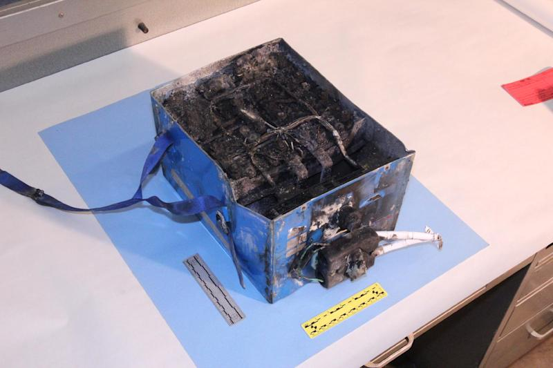 This undated photo provided by the National Transportation Safety Board shows the burned auxiliary power unit battery from a JAL Boeing 787 that caught fire on Jan. 7, 2013, at Boston's Logan International Airport. It's been nearly a quarter of a century since the last big jump in battery technology. As 21st century technology strains to be ever faster, cleaner and cheaper, the battery, an invention from more than 200 years ago keeps holding it back. It's why electric cars aren't clogging the roads and why Boeing's new ultra-efficient 787 Dreamliners aren't flying high. (AP Photo/National Transportation Safety Board)
