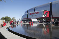 FILE - In this Thursday, Oct. 31, 2019, file photo, fans arrive prior to an NFL football game between the Arizona Cardinals and the San Francisco 49ers, in Glendale, Ariz. The San Francisco 49ers are set to embark on an unusual three-week road trip after being kicked out of their stadium and practice facility because of strict new COVID-19 protocols in their home county in Northern California. The Niners will fly to Arizona, where they will practice, live and play their next two games after Santa Clara County imposed a three-week ban on games and practices for contact sports. (AP Photo/Rick Scuteri, File)