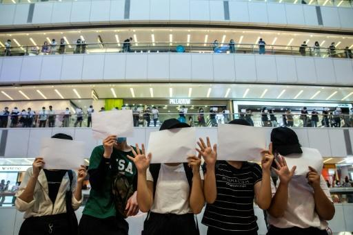Silent protests with no writing on posters have emerged in Hong Kong to circumvent China's crackdown on the democracy movement