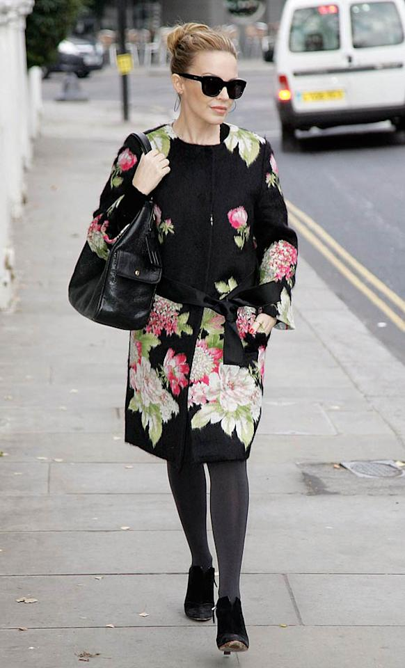 "Kylie Minogue looks beyond fabulous for 42, but the pop diva isn't doing herself any favors by donning floral granny getups out in public. Will Groves/<a href=""http://www.pacificcoastnews.com/"" target=""new"">PacificCoastNews.com</a> - December 13, 2010"