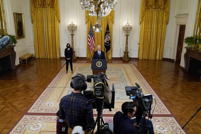 Vice President Kamala Harris, left, listens as President Joe Biden speaks about the economy, in the East Room of the White House, Monday, May 10, 2021, in Washington. (AP Photo/Evan Vucci)
