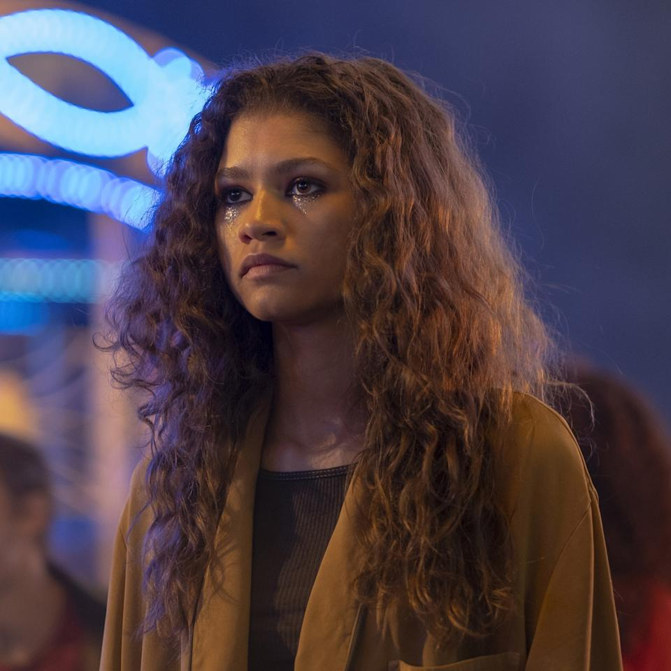 """Dubbed <a href=""""https://www.crfashionbook.com/beauty/a28468161/euphoria-hbo-zendaya-hunter-schafer-beauty-interview/"""">""""sad clown"""" makeup</a> by Davy—and the internet—Rue's shimmering under-eye makeup is a recurring theme, challenging the notion of how addicts are depicted on screen."""