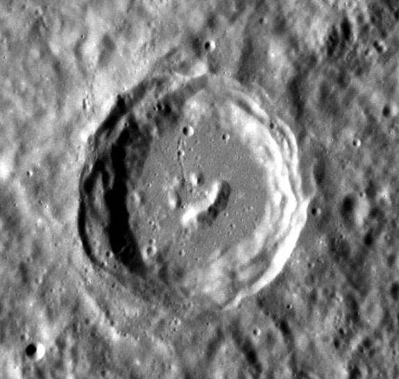 The central peaks of this complex crater on Mercury formed in such a way that it resembles a smiling face. This image was taken by NASA's Messenger spacecraft.