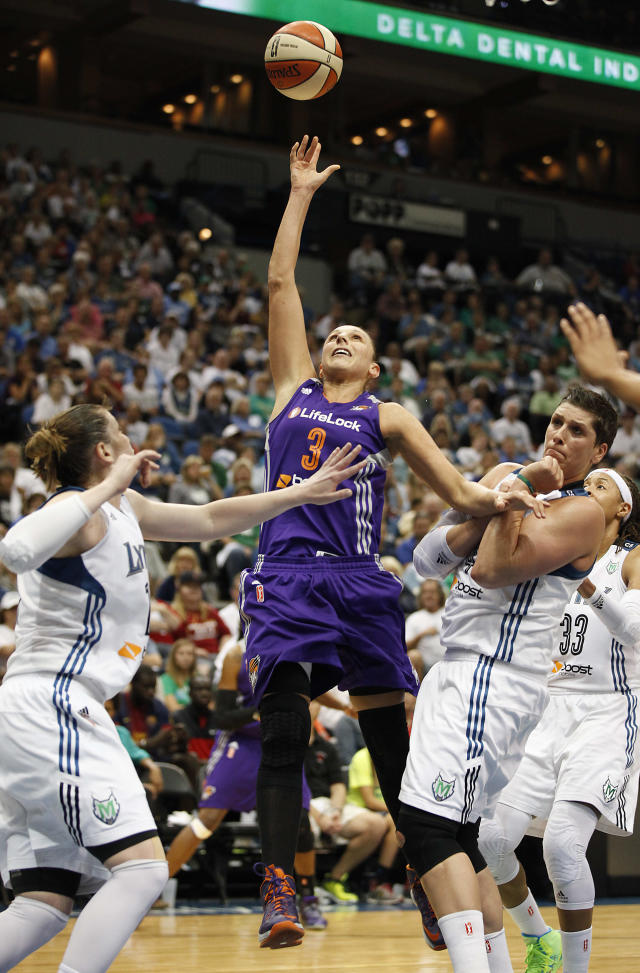 Phoenix Mercury guard Diana Taurasi (3) goes up to the basket against Minnesota Lynx guard Lindsay Whalen, left,and forward Janel McCarville (4) during Game 1 of the WNBA basketball playoffs Western Conference finals on Thursday, Sept. 26, 2013, in Minneapolis. The Lynx won 85-62. (AP Photo/Stacy Bengs)