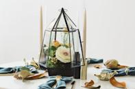 """<p>Swap gourds for soft blooms for a centerpiece that doesn't scream Thanksgiving but rather whispers it.</p><p><strong>Get the tutorial at <a href=""""https://www.cb2.com/blog/terrarium-thanksgiving-centerpiece/"""" rel=""""nofollow noopener"""" target=""""_blank"""" data-ylk=""""slk:CB2"""" class=""""link rapid-noclick-resp"""">CB2</a>.</strong></p><p><a class=""""link rapid-noclick-resp"""" href=""""https://www.amazon.com/dp/B082PR195Q/ref=sspa_dk_detail_0?tag=syn-yahoo-20&ascsubtag=%5Bartid%7C10050.g.2130%5Bsrc%7Cyahoo-us"""" rel=""""nofollow noopener"""" target=""""_blank"""" data-ylk=""""slk:SHOP TERRARIUMS"""">SHOP TERRARIUMS</a></p>"""