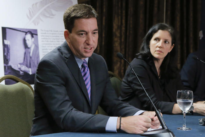 Glenn Greenwald (L) speaks to the media next to Laura Poitras during a news conference after receiving the George Polk Awards in New York, April 11, 2014. (Eduardo Munoz/Reuters)