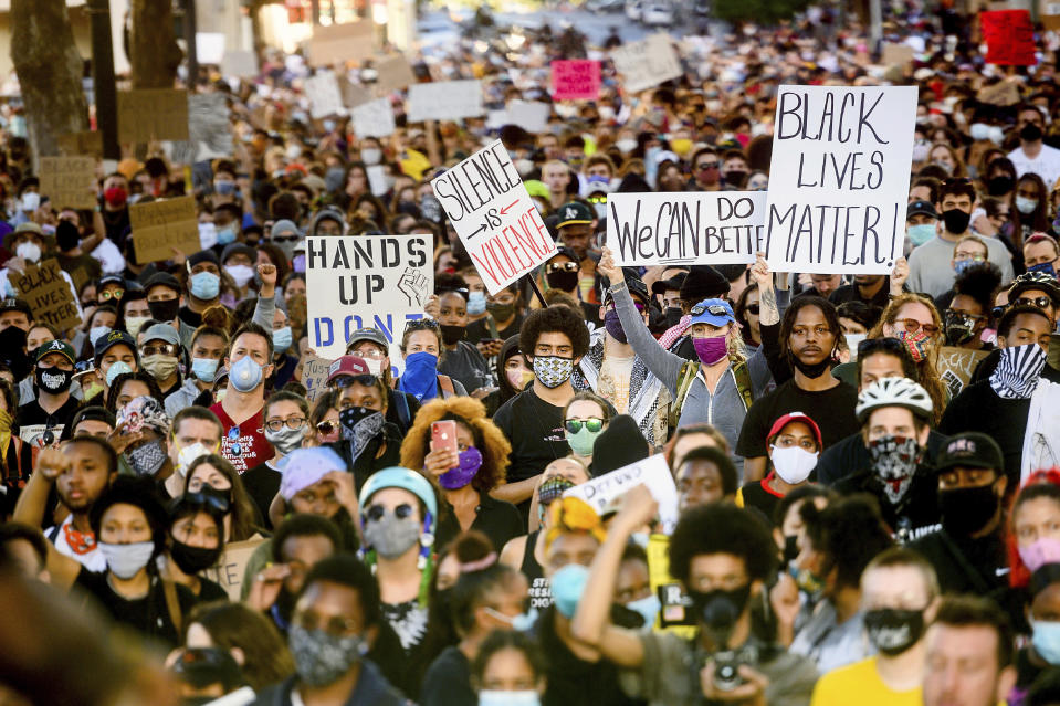 Several thousand demonstrators gather in Oakland, Calif., on Monday, June 1, 2020, to protest the death of George Floyd, who died after being restrained by Minneapolis police officers on May 25. (AP Photo/Noah Berger)