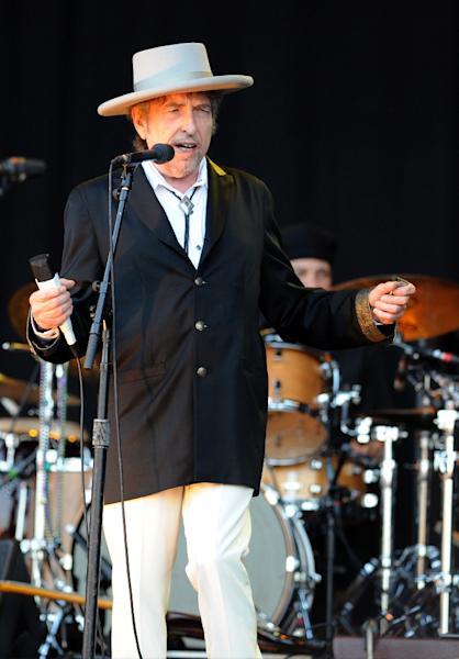 US poet and folk singer Bob Dylan performing during the 21st edition of the Vieilles Charrues music festivalin Carhaix-Plouguer, western France (AFP Photo/Fred Tanneau)