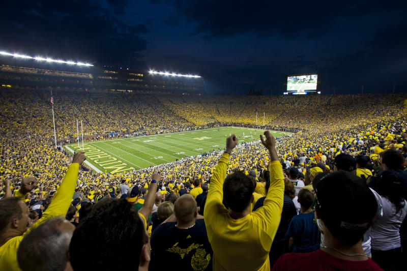 Fans cheer on Michigan and Notre Dame as they begin an NCAA college football game at Michigan Stadium, in Ann Arbor, Mich., Saturday, Sept. 7, 2013. This is only the second ever night game played at Michigan Stadium. (AP Photo/Tony Ding)