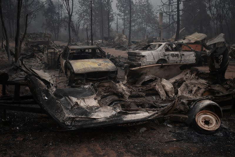 Search on for bodies in charred path of wildfires, Trump to visit California