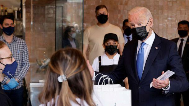 PHOTO: President Joe Biden speaks with the staff as he visits the Las Gemelas Taqueria restaurant for carry-out lunch on Cinco de Mayo in the Union Market neighborhood in Washington, May 5, 2021. (Jonathan Ernst/Reuters)