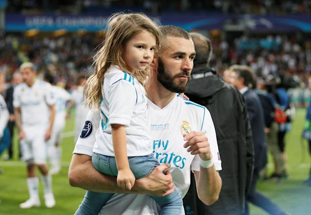 Soccer Football - Champions League Final - Real Madrid v Liverpool - NSC Olympic Stadium, Kiev, Ukraine - May 26, 2018 Real Madrid's Karim Benzema celebrates with his daughter after winning the Champions League REUTERS/Gleb Garanich