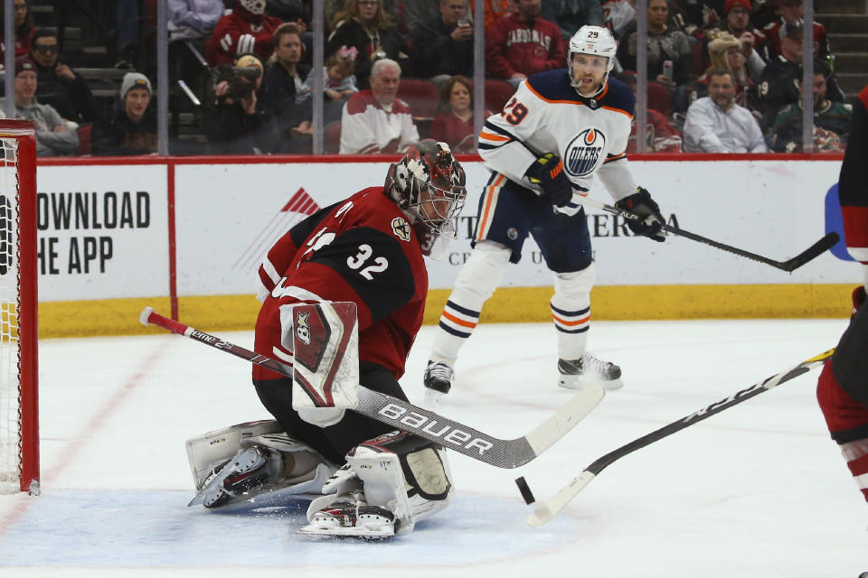 Arizona Coyotes goaltender Antti Raanta (32) makes a save on a shot from Edmonton Oilers center Leon Draisaitl (29) during the second period of an NHL hockey game Tuesday, Feb. 4, 2020, in Glendale, Ariz. The Coyotes won 3-0. (AP Photo/Ross D. Franklin)