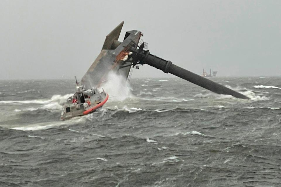 <p>A Coast Guard response boat heads toward a capsized 175-foot commercial lift boat  searching for people in the water 8 miles south of Grand Isle, Louisiana</p> (US Coast Guard Coast Guard Cutter Glenn Harris via AP)