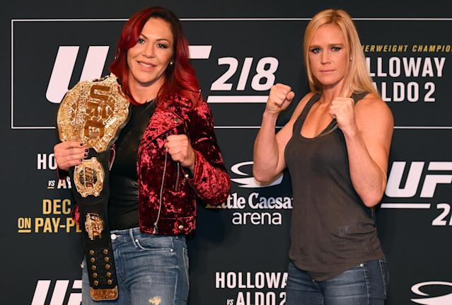 Featherweight champion Cris Cyborg (L) puts her title on the line against ex-bantamweight champion Holly Holm on Saturday in the main event of UFC 219 at T-Mobile Arena in Las Vegas. (Getty)