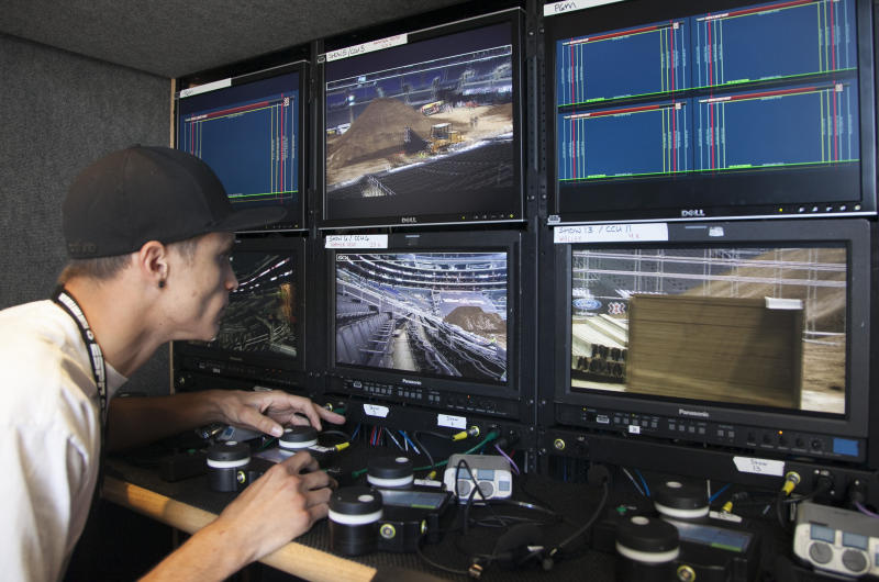 In this Wednesday, June 27, 2012 photo, 3-D TV operator Cody Miles adjusts camera focusing settings for a 3-D production for ESPN 3-D Network at the ESPN X-Games at the Staples Center in Los Angeles. Only 2 percent of TVs in American homes were able to show 3-D last year, according to IHS Screen Digest. That's about 6.9 million sets out of 331 million installed. (AP Photo/Damian Dovarganes)