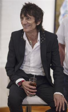 """Rolling Stones guitarist Ronnie Wood smiles as he discusses his """"Faces, Time and Places"""" gallery show in New York, April 9, 2012."""