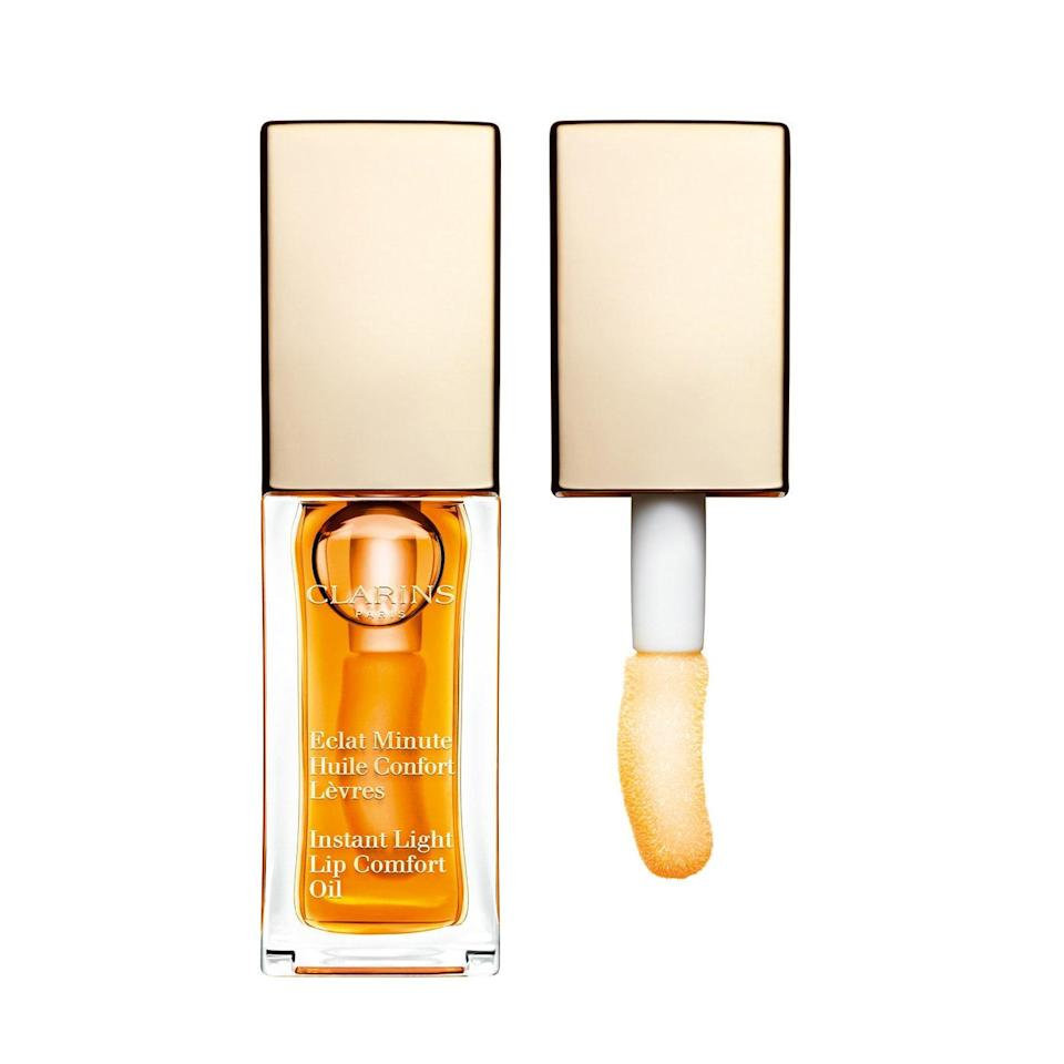 "<p>Thanks to the Clarins Lip Comfort Oil's gel texture, the hazelnut- and jojoba oil-infused elixir lasts longer than a latte, delivering comfort to even the most-chapped skin with a giant and impossible-to-smudge doe-foot applicator. Over the years, Clarins has bolstered the shade range of its beloved lip oil, so if you want your shine to have a hint of glitter or color, you're sure to find whatever you have in mind. </p> <p><strong>$26 (</strong><a href=""https://shop-links.co/1631844462780021842"" rel=""nofollow noopener"" target=""_blank"" data-ylk=""slk:Shop Now"" class=""link rapid-noclick-resp""><strong>Shop Now</strong></a><strong>)</strong></p>"