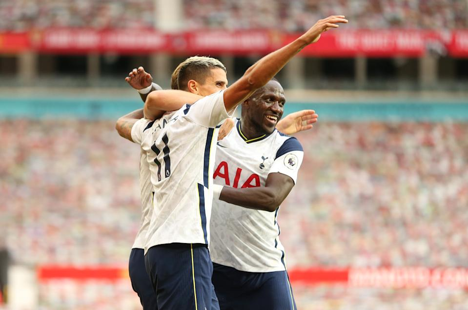 MANCHESTER, ENGLAND - OCTOBER 04: Harry Kane of Tottenham Hotspur celebrates after scoring his sides third goal with teammates Erik Lamela and Moussa Sissoko during the Premier League match between Manchester United and Tottenham Hotspur at Old Trafford on October 04, 2020 in Manchester, England. Sporting stadiums around the UK remain under strict restrictions due to the Coronavirus Pandemic as Government social distancing laws prohibit fans inside venues resulting in games being played behind closed doors. (Photo by Tottenham Hotspur FC/Tottenham Hotspur FC via Getty Images)