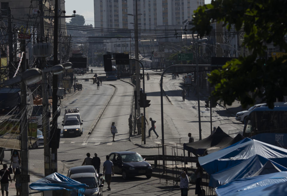 An avenue is partially empty amid increased restrictions on movements in an effort to curb the spread of the new coronavirus in the Madureira neighborhood of Rio de Janeiro, Brazil, Tuesday, May 12, 2020. (AP Photo/Silvia Izquierdo)
