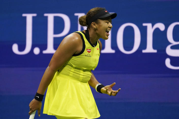 Naomi Osaka, of Japan, reacts during a match against Leylah Fernandez, of Canada, at the third round of the US Open tennis championships, Friday, Sept. 3, 2021, in New York. (AP Photo/John Minchillo)