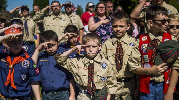 PHOTO: Boy Scouts and Cub Scouts salute during a Memorial Day ceremony in Linden, Mich., May 29, 2017. (Jake May/The Flint Journal - MLive.com via AP)