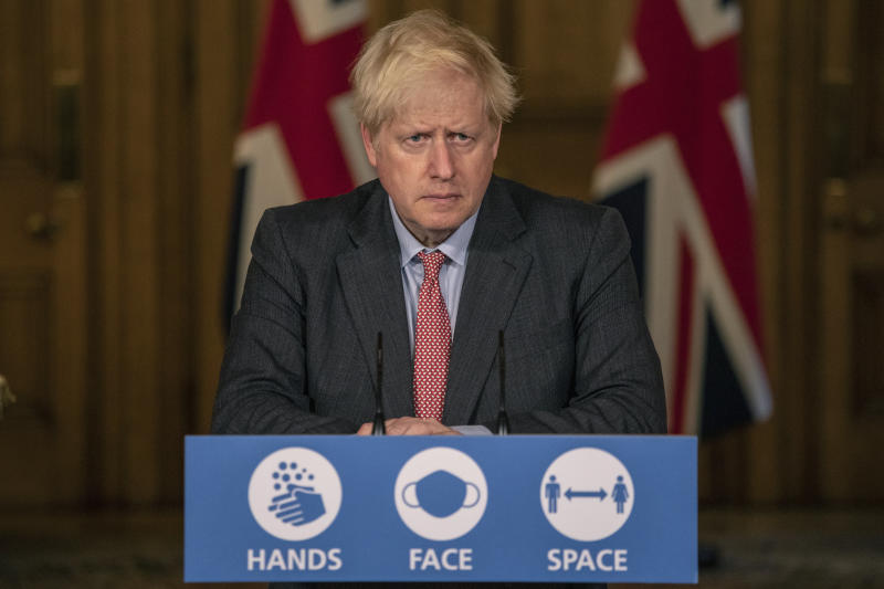 Britain's Prime Minister Boris Johnson listens, during a coronavirus briefing in Downing Street, London, Wednesday, Sept. 30, 2020. The number of new hospitalizations for COVID-19 and virus deaths in Britain are rising again, although both remain far below their springtime peak. (Jack Hill/Pool Photo via AP)