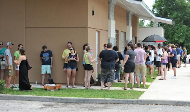 <p>Potential blood donors line up outside the oneblood facility on Beach Blvd. In Jacksonville, Fla., June 12, 2016, to help the victims from the shooting at a nightclub in Orlando. (Bob Self/The Florida Times-Union via AP) </p>