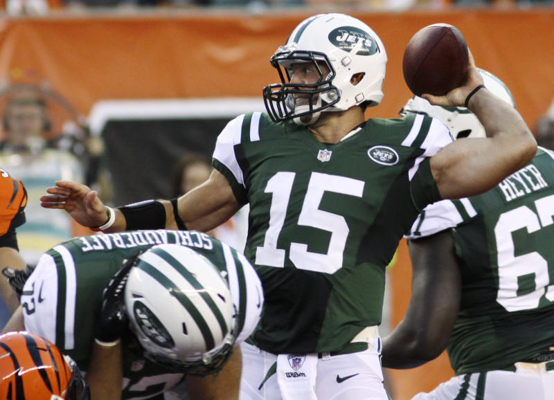 New York Jets quarterback Tim Tebow passes against the Cincinnati Bengals in the first half of an NFL preseason football game, Friday, Aug. 10, 2012, in Cincinnati. (AP Photo/Tom Uhlman)