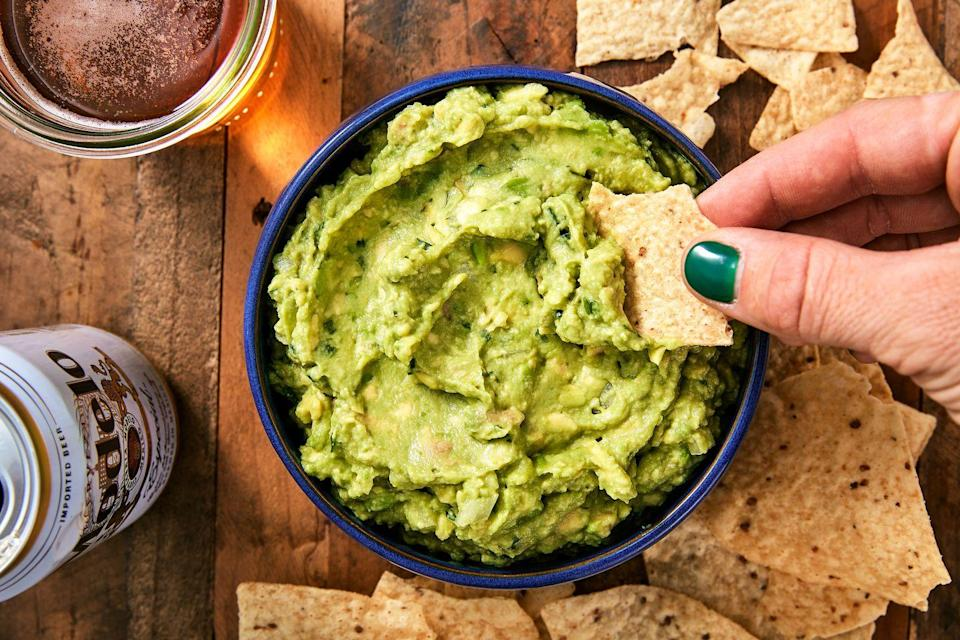 """<p>Is it even a party without guacamole?</p><p>Get the recipe from <a href=""""https://www.delish.com/cooking/recipe-ideas/recipes/a45570/best-ever-guacamole-recipe/"""" rel=""""nofollow noopener"""" target=""""_blank"""" data-ylk=""""slk:https://www.delish.com/cooking..."""" class=""""link rapid-noclick-resp"""">https://www.delish.com/cooking...</a>Delish.</p>"""
