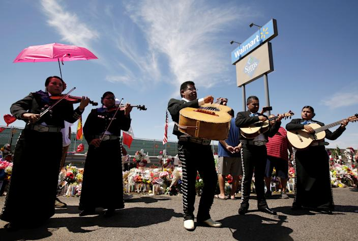 Mariachis play during a tribute to the victims of a mass shooting at a Walmart store, in the growing memorial in El Paso, Texas, U.S., August 18, 2019. REUTERS/Jose Luis Gonzalez
