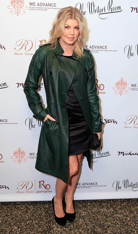 Fergie hit the red carpet wearing a green leather version of the coat that never goes out of style! (11/09/2011)