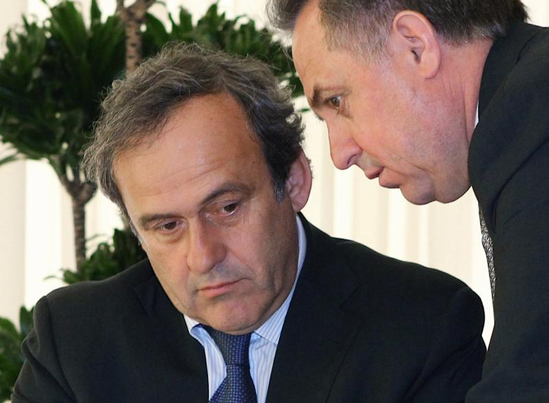 UEFA President Michel Platini, left, and  Russian Sports Minister Vitaly Mutko speak before a meeting with Russian President Vladimir Putin in the Bocharov Ruchei residence in the Black Sea resort of Sochi, Russia, Wednesday, April 17, 2013. (AP Photo/RIA-Novosti, Mikhail Klimentyev, Presidential Press Service)